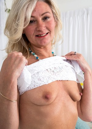 Granny with hanging tits works her old pussy 5